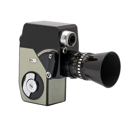 The old movie camera is isolated on a white background.