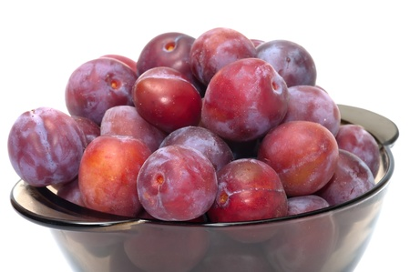 Ripe plums on a plate isolated on a white background. Stock Photo - 17693348