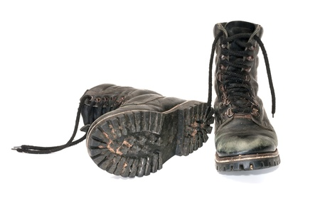 muddy clothes: Pair worn army boots it is isolated on a white background.