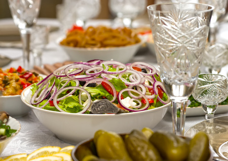 Greek salad close up on the festive table.