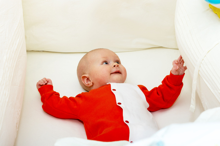 Close up shot of boy newborn in cot Stock Photo