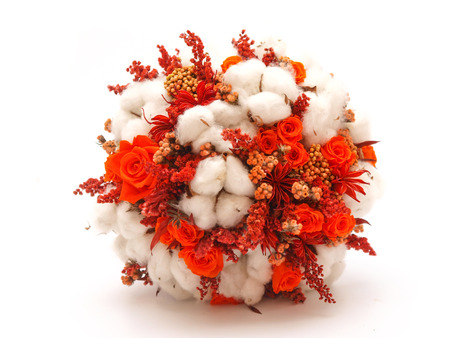 Preserved flowers and cotton wedding bouquet on white background