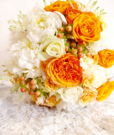 lace background: Vintage orange ivory white wedding bouquet on lace background