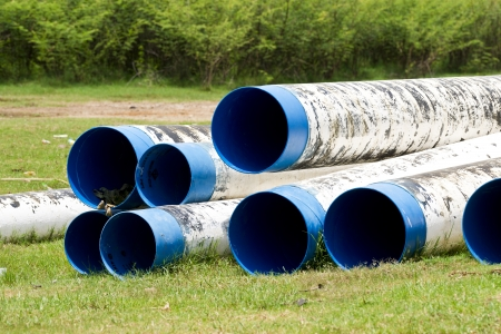 residential tree service: pipes  in  garden Editorial