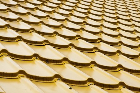 Brand new yellow rooftop against  Stock Photo