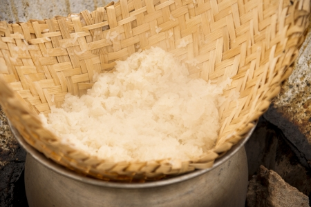 Stainless pot and craft for sticky rice cooking photo