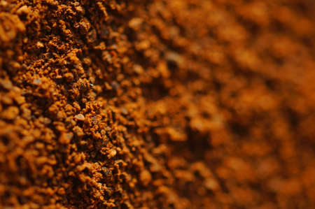 Ground coffee in macro magnification. Daylight, visible details, natural background. Blurred frame elements for promotional text.