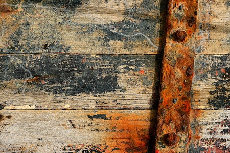 decayed: Texture wood on side boat and rust