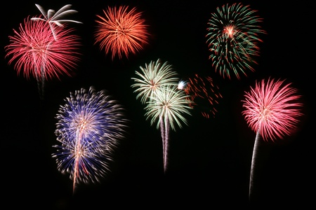 long exposure of multiple fireworks against a black sky