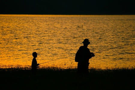 Family fishing together in lake at Thailand Stock Photo
