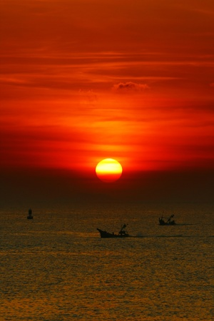 Fisherman Boat in sunset at Koh Samui, Thailand photo