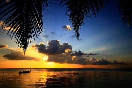 Fisherman Boat in sunset at Koh Samui, Thailand Stock Photo