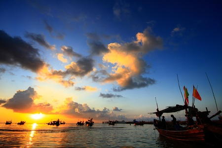 over the sea: Fisherman Boat in sunset at Koh Samui, Thailand Stock Photo