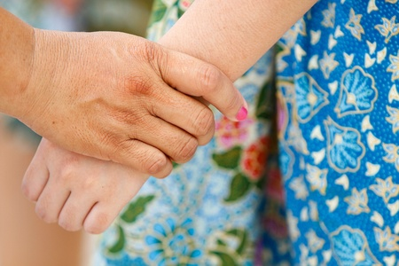 caring hand of a nurse and a senior patient photo