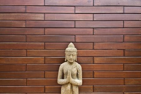 Buddha on wooden wall photo