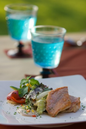 Salad salmon with cream sauce on romantic dining table photo