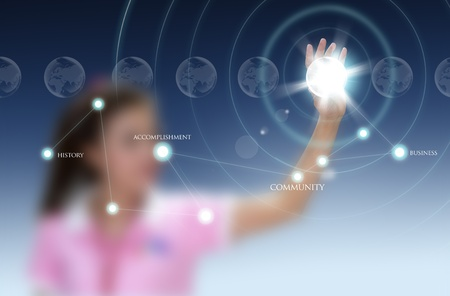 hightech: woman pushing a world map on a touch screen interface Stock Photo
