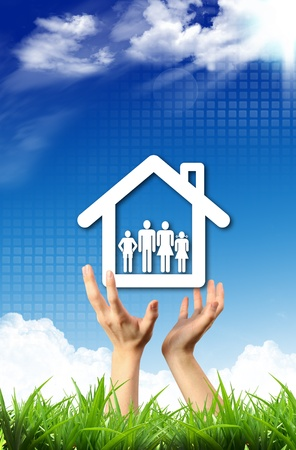 Protect family house in human hand Stock Photo