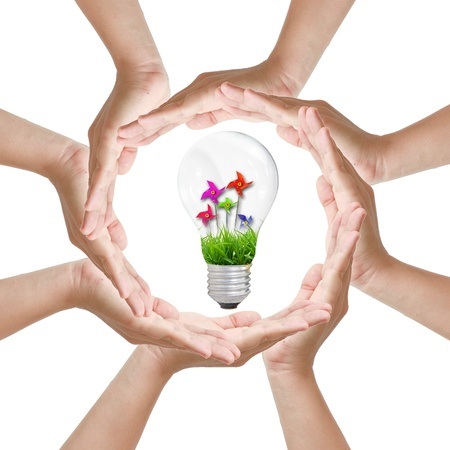Multiracial woman hands making a circle with Light bulb toy photo
