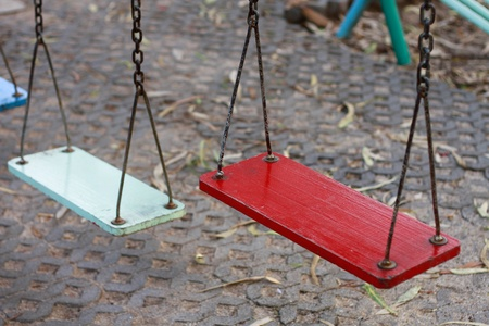 Swing in the playground for kid photo