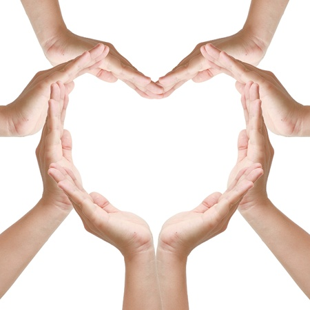 copy: Hands make heart shape on white background