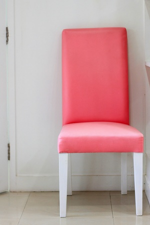 Pink chair in white room at Dental clinic photo