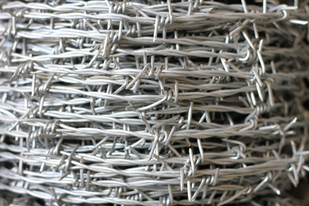 A roll of barbed wire background Stock Photo - 12473380