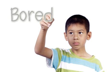 Kid writing bored on white background Stock Photo - 13348936