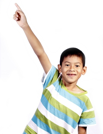 pointing up: Child pointing his finger isolated on white background Stock Photo