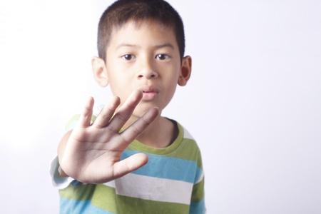 little asian boy portrait in studio on white background