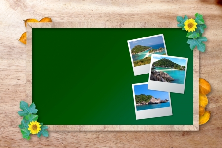 chalkboard with island picture on wood background photo