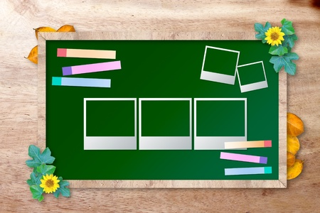 chalkboard with photo frame on wood background photo