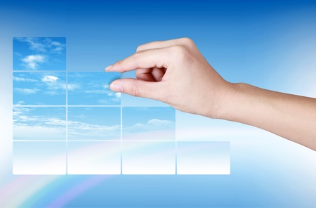 Sky card saparate in hand on blue background Stock Photo