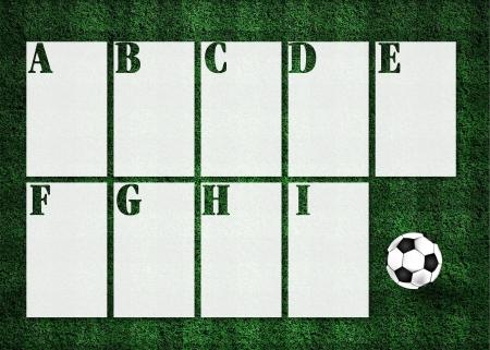 score table soccer in green grass field photo