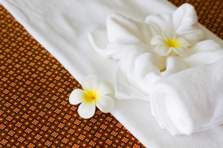 Towels with flower in thai spa room photo