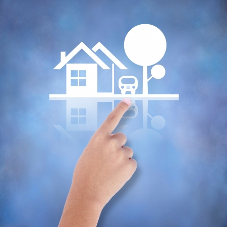 home value: business hand with the family house icon Stock Photo