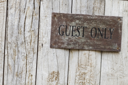Guest Only Sign on wooden door photo