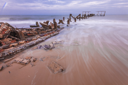 Long exposure shot of old pier at seascape. Soft focus due to long exposure shot. Composition of nature.
