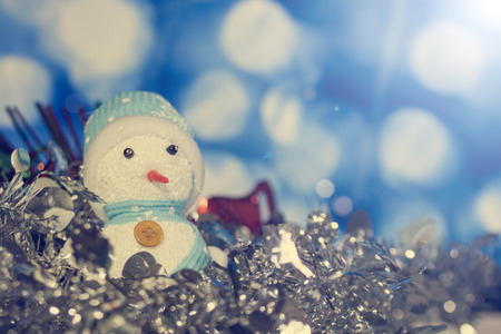 mulberry paper: snowman on bokeh for Christmas background Stock Photo