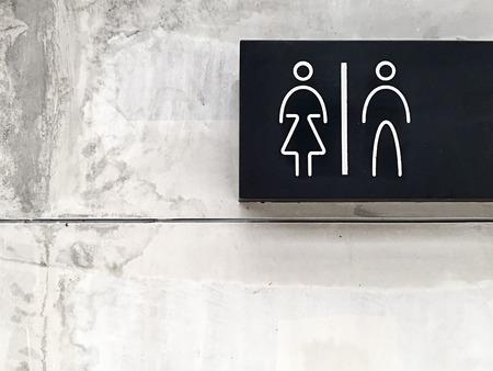 bathroom wall: Signs bathroom on cement wall