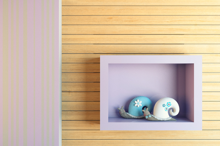 carved letters: snail toy at the shelf