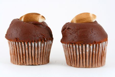 This is a Homemade chocolate Cupcake with sugar football. Stock Photo