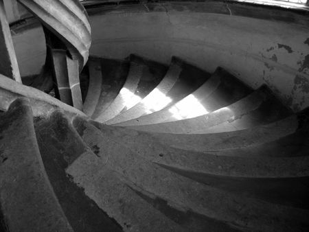 These are Stone Spiral Stairs Black and White  photo