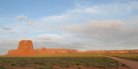 This is an image from Monument Valley with a Red Dirt road Stock Photo - 2776225