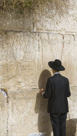 this is a Hasidic Man Praying at the Western Wall, Jerusalem