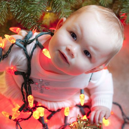 This is a Baby wrapped in Xmas Lights Stock Photo - 6054909