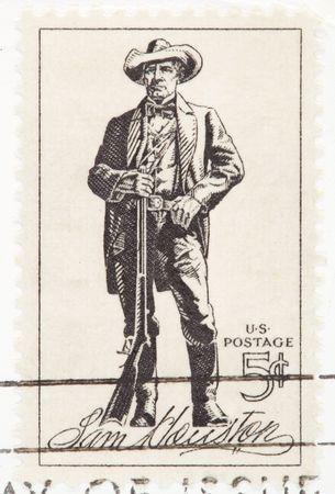 postmark: USA - CIRCA 1964: A stamp printed by USA shows the Sam Houston with a rifle circa 1964.