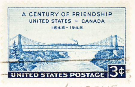 USA - CIRCA 1948: A stamp printed by USA celebrate a century of friendship between Canada and USA circa 1948