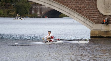 sculling: BOSTON - OCTOBER 18: In the Head of Charles Regatta, On October 18th, 2008 Mark Fagan of Harvard Sculling Club races to pass under the Weeks Footbridge finishing 55th.