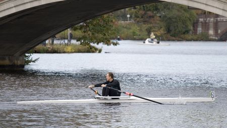 sculling: BOSTON - OCTOBER 18: In the Head of Charles Regatta, On October 18th, 2008 Racer Tim Stormraces to pass under the Weeks Footbridge finishing in the top 10.